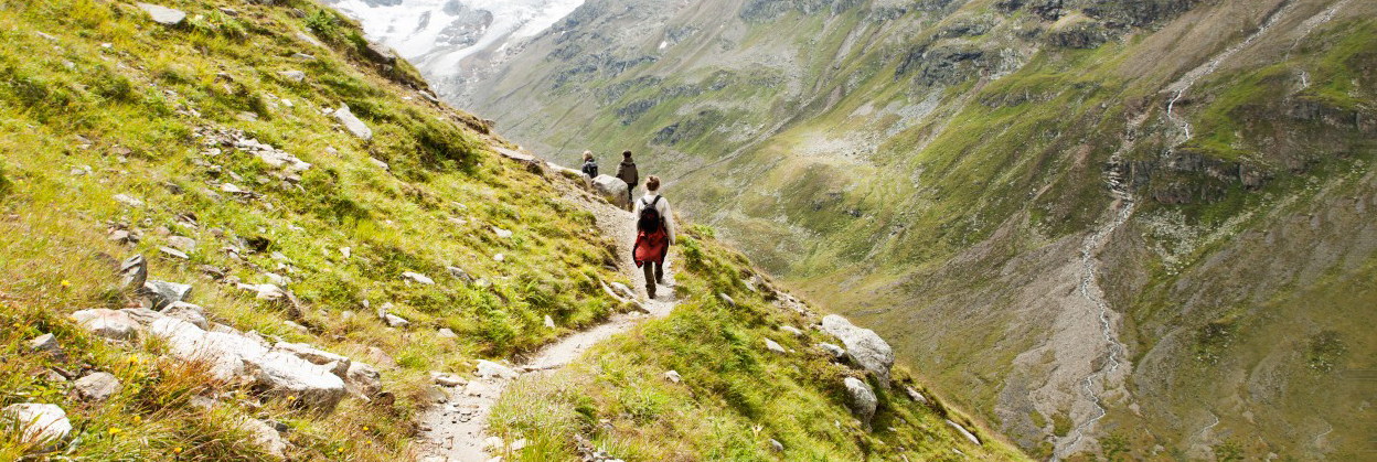 Family hiking in Alps